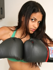 Polliana spars with the camera wearing her boxing gloves.