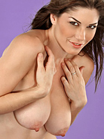 Kym shows off her large natural breasts