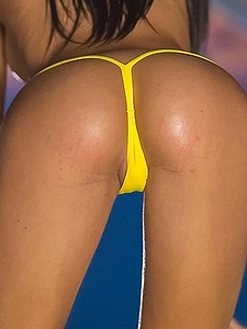 Denise Gomez Oiled in Yellow String Bikini