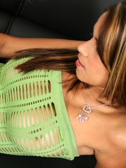Polliana showing off her amazing, luscious tits in a open-slit green top, while also teasing peeks of her pussy and ass in thin lace black nylons.